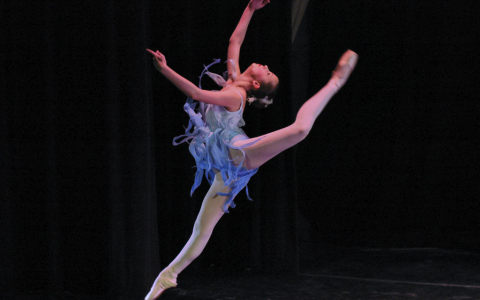 Blue Costumed Contemporary Ballet Dancer in Mid Leap