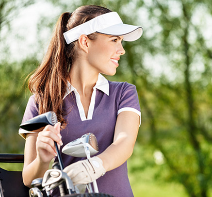 a girl holding golf clubs