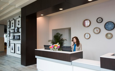 woman sitting at front desk in the lobby