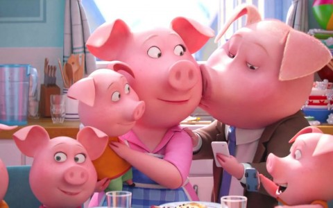 an animated pink pig family sitting around a dinner table