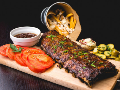 bbq platter of ribs tomato and frenchfries