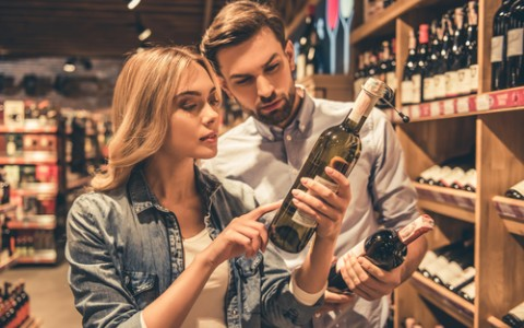 couple choosing a bottle of wine