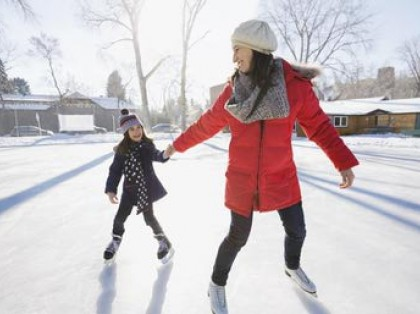 a mom and daughter ice skating
