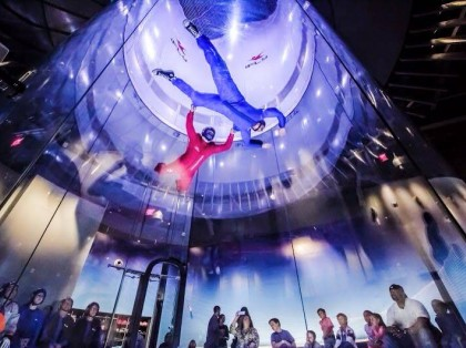People indoor skydiving