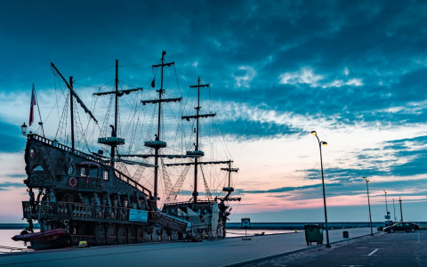 pirate ship docked at sunset