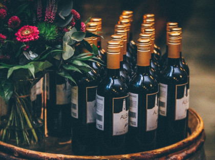 wine bottles and flowers displayed on a tray