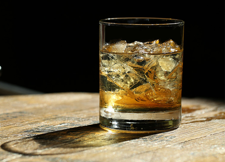 Close up of glass with bourbon on the rocks