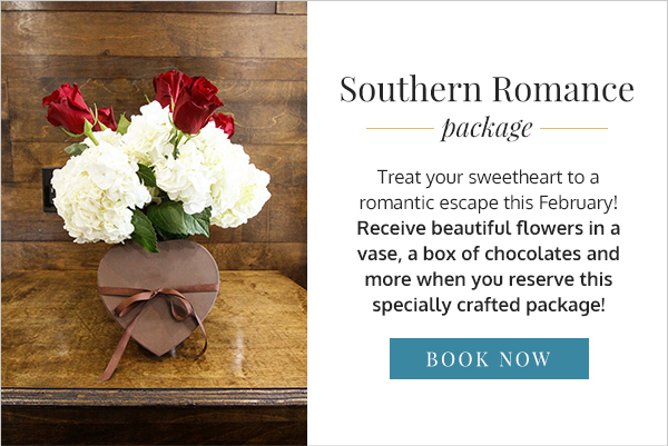 Flowers and box of chocolates on nightstand with text saying southern romance package on the right