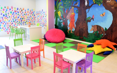 Kids club with colorful wall and chairs with a play area