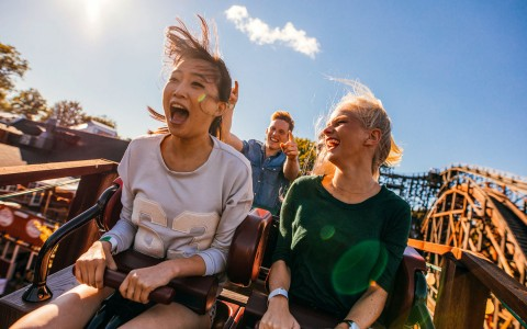 young girls on roller coaster