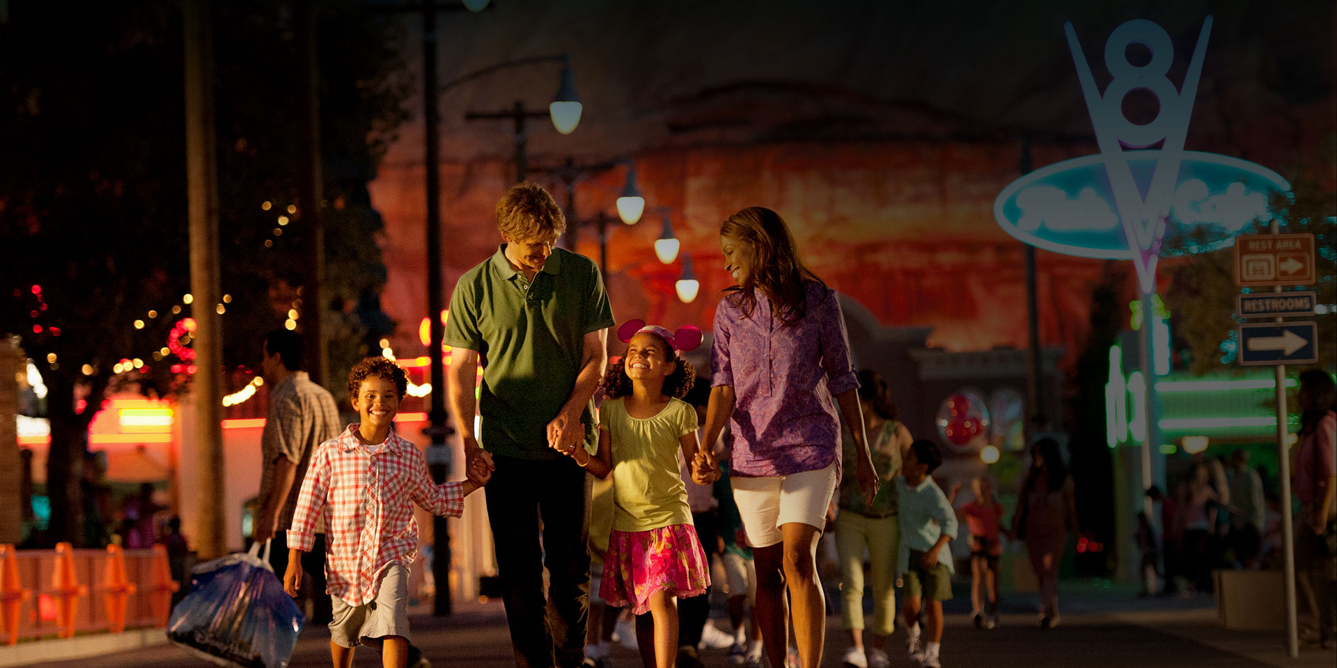 family walking on the street at night