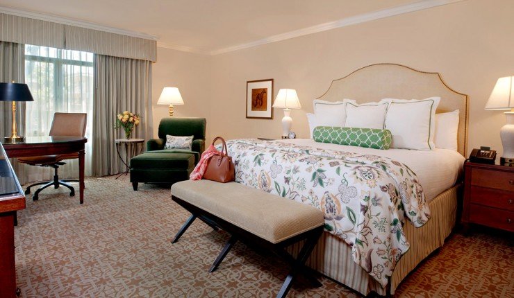 queen bed with footer and green chair