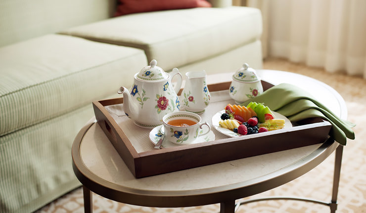 tea set on coffee table with fruit