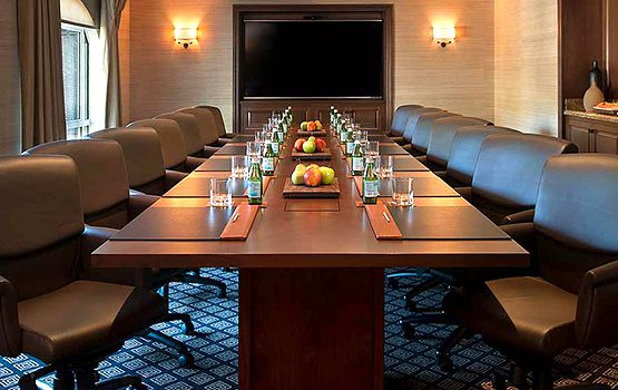 a meeting room with a conference table and chairs