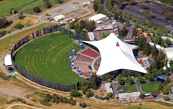 Aerial of SHORELINE AMPHITHEATER with grassy lawn and white tent