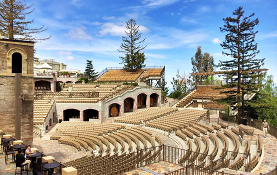 MOUNTAIN WINERY with stone seating area on a sunny day