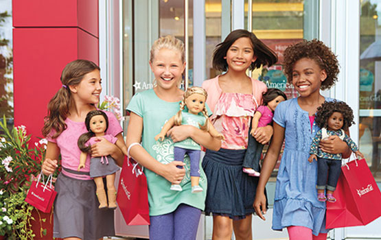 Four Girls holding American Girl dolls