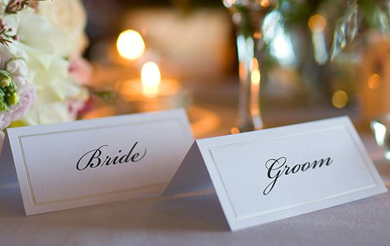 Bride and Groom name place cards on table