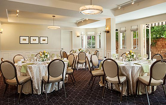 Event E Round Tables With White Table Cloths And Chairs Stanford Room