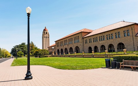 Stanford University building with lightpost in foreground
