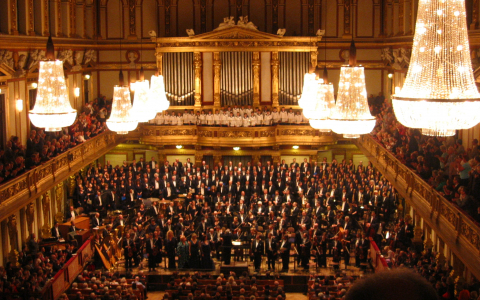 Symphony and boys choir in opulent concert hall
