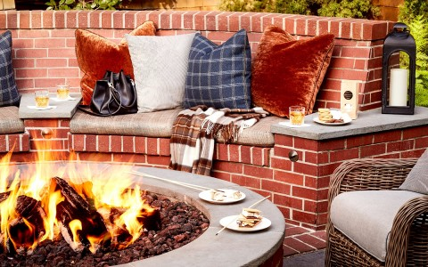 fire pit by brick seating area with smores