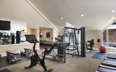 stanford park hotel gallery 12 fitness center with peloton bike and weight equipment