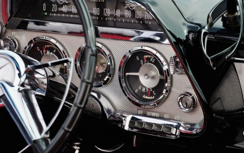 vintage car interior showing dials by the steering wheel