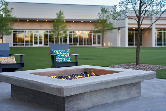 firepit with chairs outside