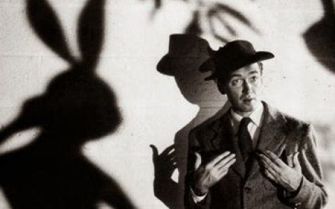 Black and White Photo of Jimmy Stewart and His Pal Harvey in a Still From the Movie Harvey