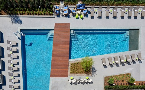 aerial view of the pool with lounge chairs