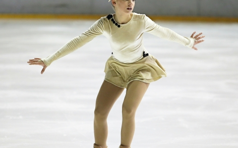 Young female figure skater on the ice