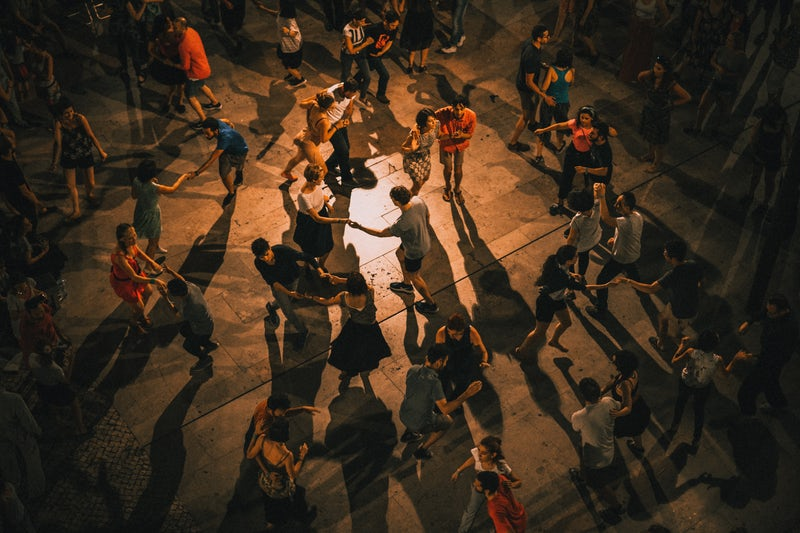 aerial photo of people salsa dancing on wood floor