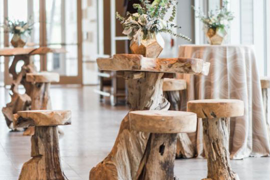 close up of wooden tables and stools