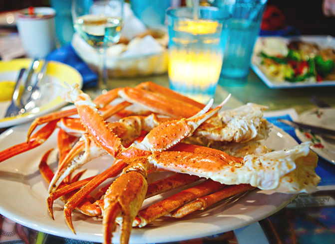 crab legs on a plate with water