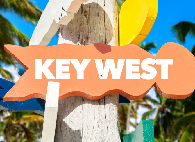 key west sign in orange white letters