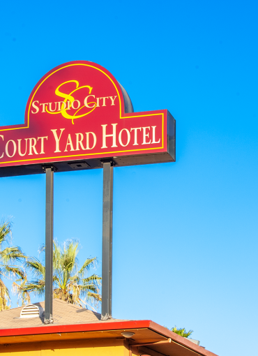 exterior signage of studio city court yard hotel