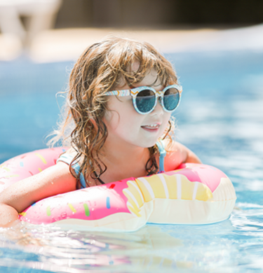 little girl on a float in the pool