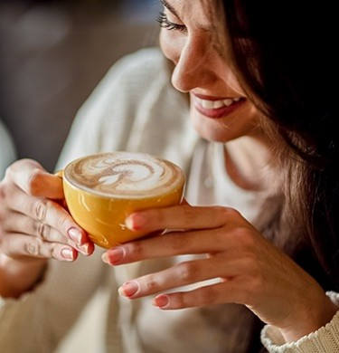 woman drinking a cappuccino