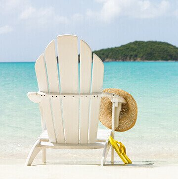 Chair on the beach with a hat