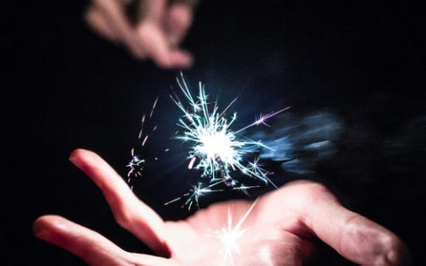 A Spark of lightin a hand to show magic