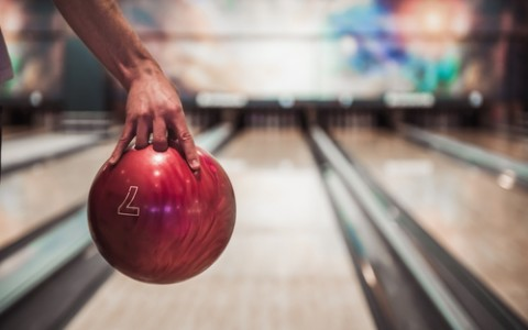 hand holding a red bowling ball