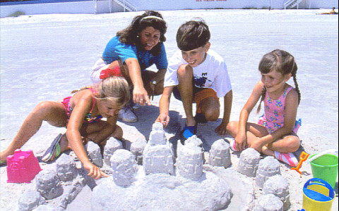 children making sandcastles on the beach