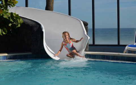 child going down a waterslide