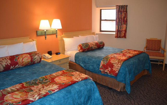 Limited View Suite - Plan 5-Guest room with two queen beds and orange wall