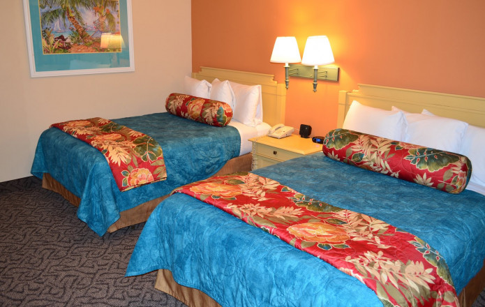 Limited View Suite - Plan 5-Guest room with two queen beds and orange wall - left