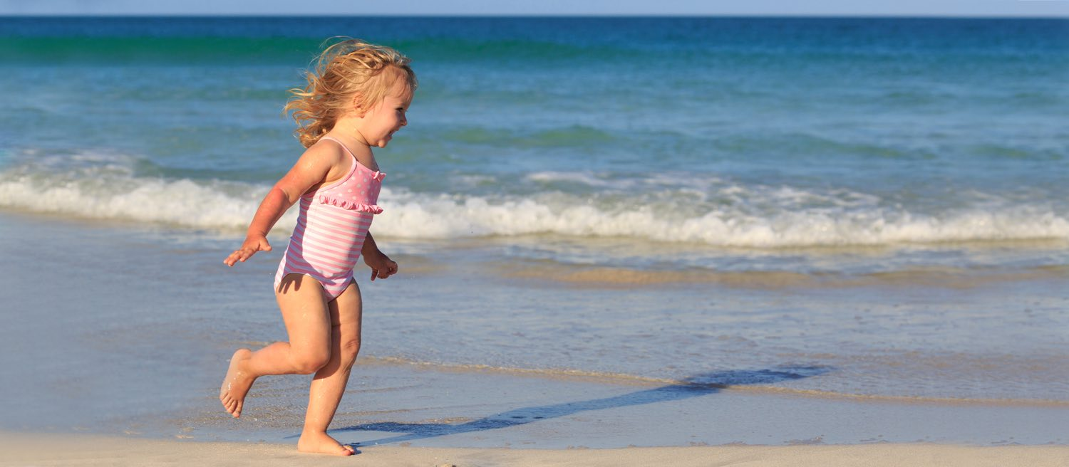 sunviking homepage hero 03 little girl running on the beach
