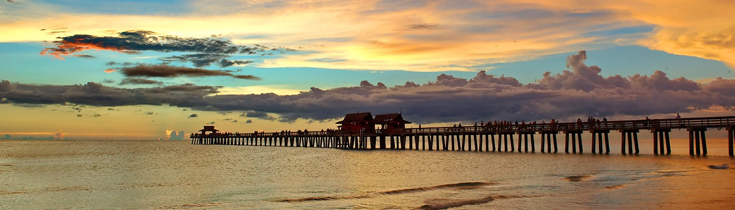 sunset sky with pier over the water
