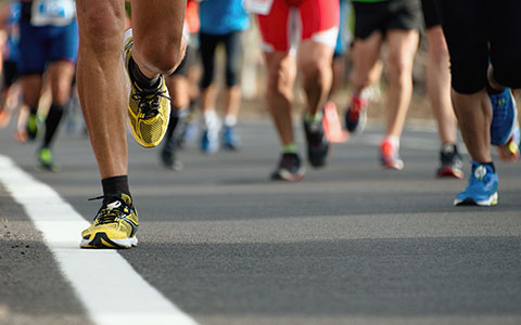 close up image of peoples shoes while running