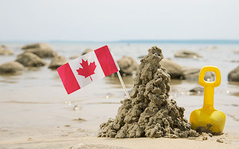 Canadian flag mounted in sand